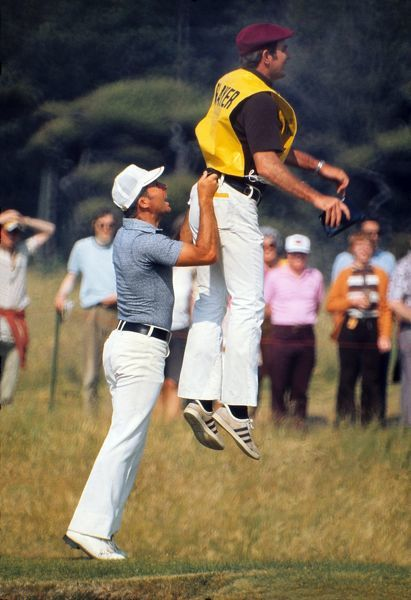 Gary Player gives his caddy a lift to look at the green.  1972 Open Championship, Muirfield, 1972. Credit: Colorsport