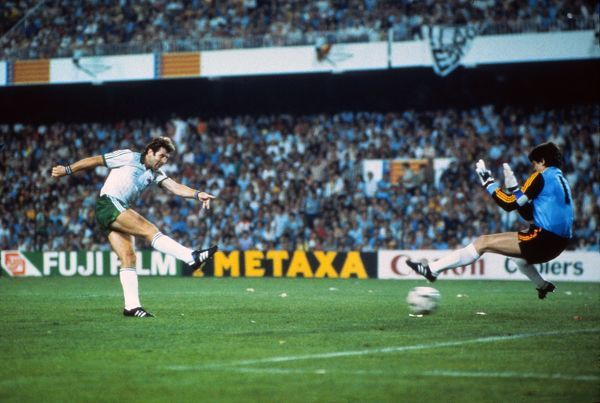 Football - 1982 World Cup - First Round, Group Five: Northern Ireland 1 Spain 0 Gerry Armstrong scores the only goal of the game for Northern Ireland past goalkeeper Luis Arconada at the Estadio Luis Casanova, Valencia. 25/06/1982