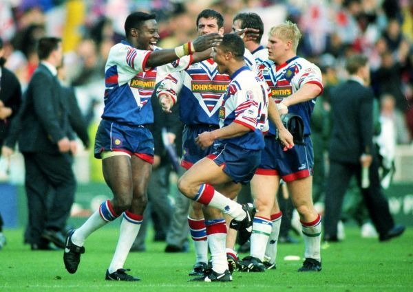 RUGBY LEAGUE Great Britain's Martin Offiah (left) and Jason Robinson celebrate at the end of the game. Great Britain 8 Australia 4 1st Test Wembley Stadium