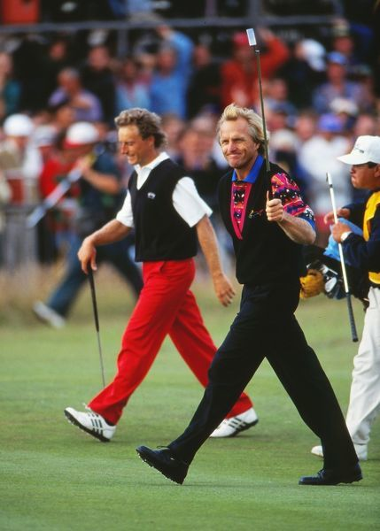 Golf - Greg Norman and Bernhard Langer walk up the Fairway on the 18th of their final round. British Open golf Championship 1993 @ Ryal St Georges Sandwich. 15 -18/07/1993 Credit : Colorsport / Stuart McFarlane