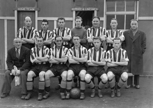 Football - 1952 / 1953 season - Grimsby Town Team Group   Back (left to right): H. Hart, Walter Galbraith, R. Scotson, S. Hayhurst, D. McMillan, P. Johnston, Bill Shankly (Manager).  Front: T. Dawson (trainer), S. Lloyd, A. McCue, W. Brown, J