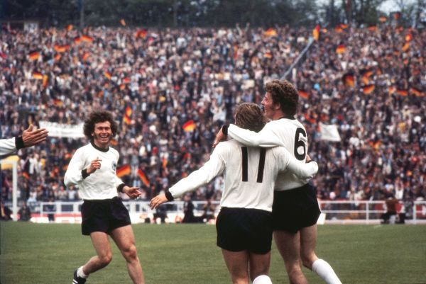 Football - 1972 UEFA European Football Championship - Final: West Germany 3 Soviet Union 0 West Germany's Herbert Wimmer (#6) celebrates his goal with Erwin Kremers (#11) and Paul Breitner, left, in the Heysel Stadium, Brussels