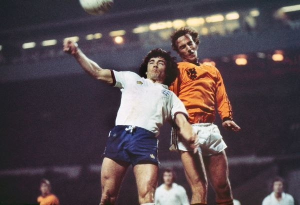 Football - 1976 / 1977 season - England 0 Netherlands 2 Johan Neeskens and Kevin Keegan at Wembley. 09/02/1977
