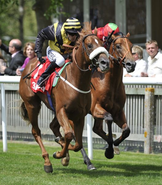 Horse Racing - Newmarket Races - July Cup Meeting Red Duke ridden by Kieren Fallon (Noseband) wins the Superlative Stakes ahead of Chandlery