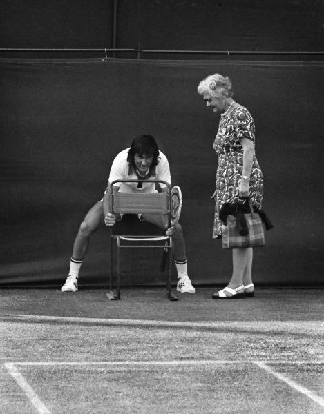 Ille Nastase - Romania entertains the crowd as he lines up the lines womans chair on no. 2 court. Wimbledon tennis Championships 1975. 02/07/1975 Nastase v Alexander. Credit : Colorsport / Andrew Cowie