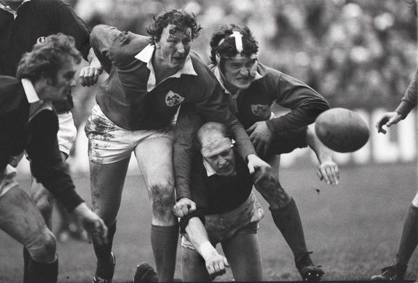 Rugby Union - 1978 Five Nations Championship - Ireland 12 Scotland 9 Ireland's Willie Duggan, left, and John O'Driscoll sandwich Scotland's Mike Biggar as they all compete for the ball at Lansdowne Road