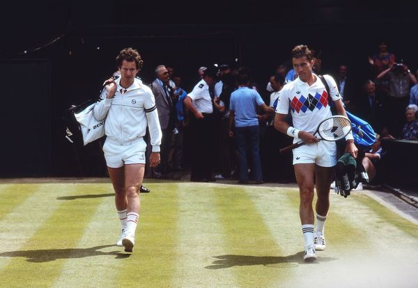 Tennis - 1983 Wimbledon Championship - Men's Singles Semi-Final Ivan Lendl and John McEnroe walk onto Centre Court. McEnroe won the match 7-6, 6-4, 6-4 to progress to the final