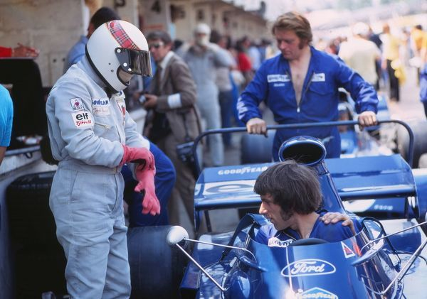 Motorsport - Formula One F1 World Championships - British Grand Prix Practice Jackie Stewart and the Tyrrell mechanics prepare his car for practce at Brands Hatch