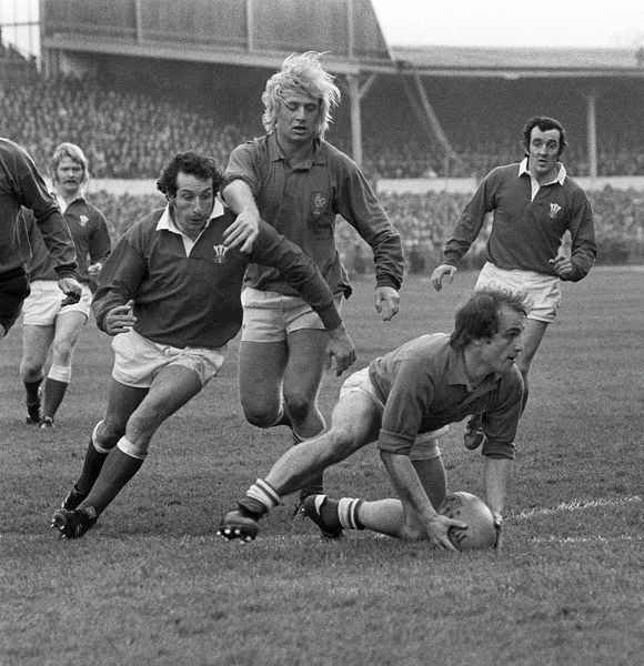 Rugby Union - 1976 Five Nations Championship - Wales 19 France 13 France's Jacques Fouroux looks to pass, with teammate Jean-Pierre Rives behind, and Wales' Gareth Edwards, left, and Phil Bennett, right, at Cardiff Arms Park