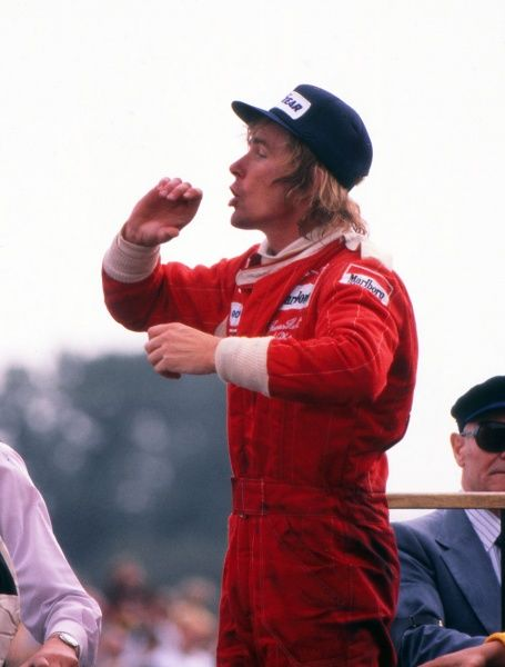 Motor Racing - 1976 Formula One (F1) World Championship - British Grand Prix McLaren's James Hunt calls for the champagne after winning the race at Brands Hatch. Two months later Hunt was disqualified due to an incident at the start of the race