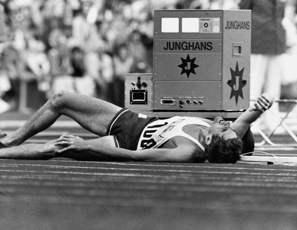 Athletics - 1972 Munich Olympics - Men's 1500m Round One Heat Four Jim Ryun of USA lies on the track after colliding with Ghana's Billy Fordjour with 500 metres to go in the Olympiastadion, Munich, West Germany. Ryun, the world record holder