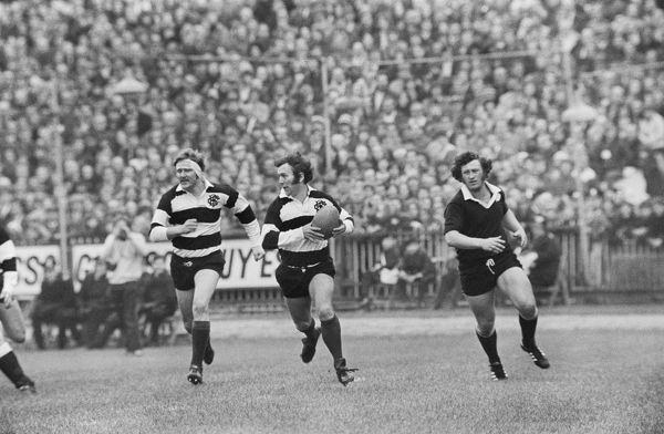 Rugby Union - 1972 / 1973 New Zealand Tour of Great Britain & France - Barbarians 23 New Zealand 11 Barbarian captain John Dawes makes the break that leads to Gareth Edwards (not pictured) famous try at Cardiff Arms Park