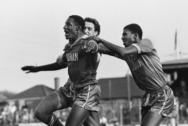 Football - Wimbledon vs. Southampton John Fashanu of Wimbledon, celebrates his goal with Carlton Fairweather and Mark Morris