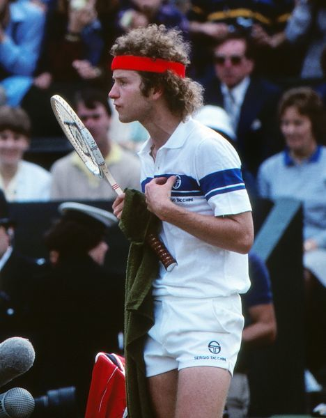 Tennis - 1981 Wimbledon Championships - Men's Singles Semi-Finals John McEnroe complains to the referee during his 7-6, 6-4, 7-5 victory over Rod Frawley