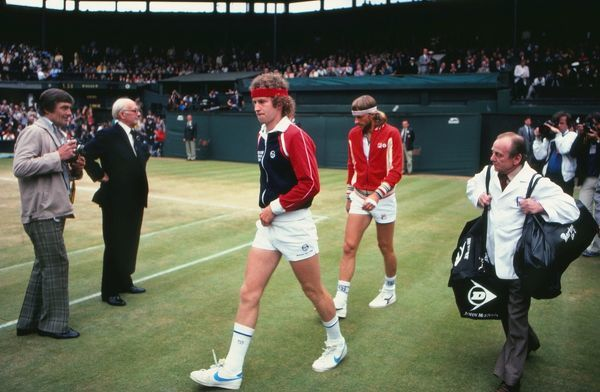Tennis - 1981 Wimbledon Championships - Men's Singles Final John McEnroe and Bjorn Borg walk out onto Centre Court. McEnroe won the match 4-6 7-6 7-6 6-4