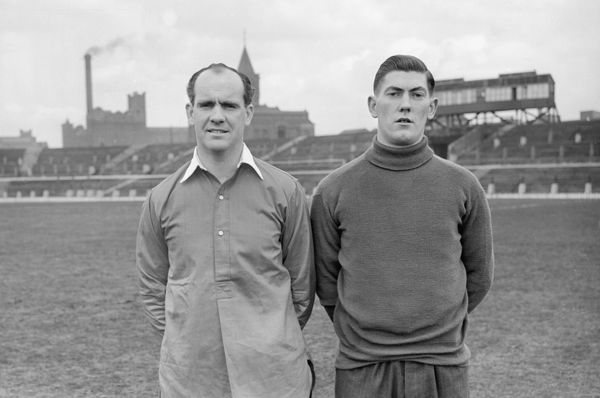 Johnny Carey (United Captain ) with John Ignatius 'Sonny' Feehan (Manchester United) 1948 / 49 season. Also Ireland International Photocall. Credit : Colorsport