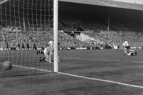 Football - 1961 The British Home Championship - England 9 Scotland 3 England's Johnny Haynes scores goal number six from the edge of the box past Scotland keeper Francis Haffey at Wembley