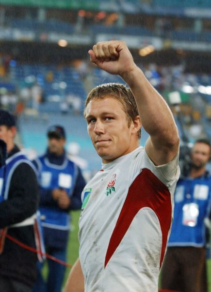 Rugby Union - The 2003 World Cup Final - England 20 Australia 17 (a.e.t.) Jonny Wilkinson (England) salutes the fans after the match. Telstra Stadium (now Stadium Australia), Sydney, Australia