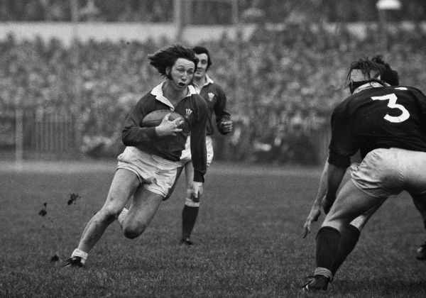 Rugby Union - 1976 Five Nations Championship - Wales 28 Scotland 6 Wales full back JPR Williams in full flight in Cardiff Arms Park