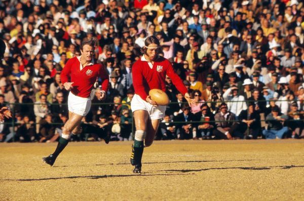 Rugby Union - 1974 British Lions Tour to South Africa - Eastern Transvaal 10 British Lions 33 (23/7/1974) Lions full back JPR Williams prepares to kick ahead, with teammate Mike Gibson, behind, during the game in Springs
