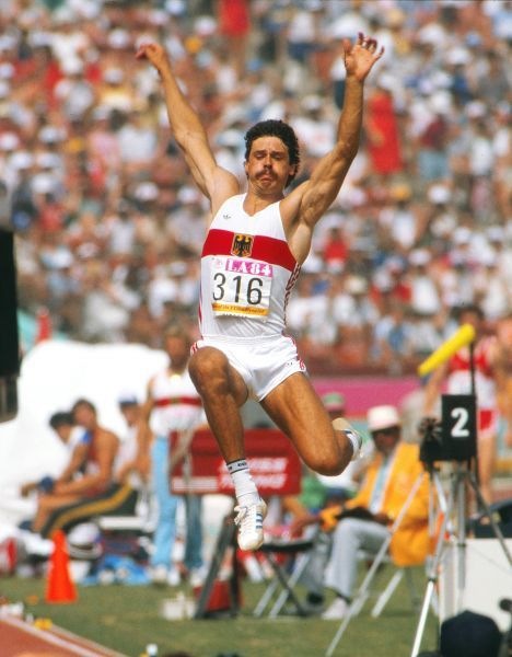 Athletics - 1984 Los Angeles Olympics - Men's Decathlon Day 1 West Germany's Jurgen Hingsen in the long jump event in the Los Angeles Memorial Coliseum. Hingsen went on to win the silver medal