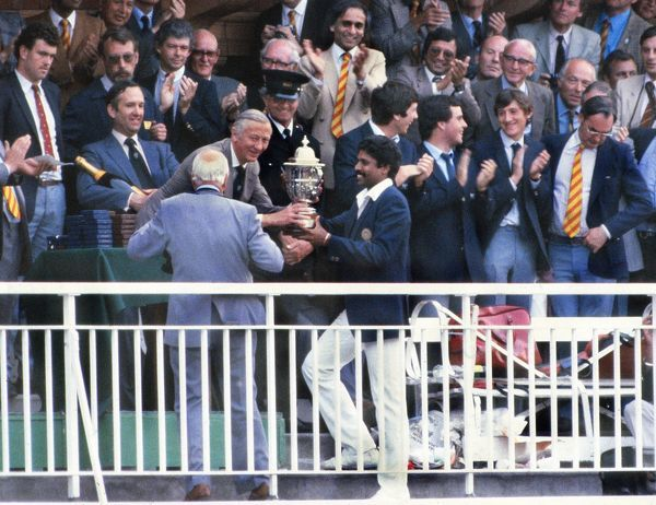 Cricket - 1983 Prudential Cricket World Cup Final - India vs. West Indies (25/06/1983) Indian captain Kapil Dev collects the trophy on the Lords balcony. India had won the game by 43 runs