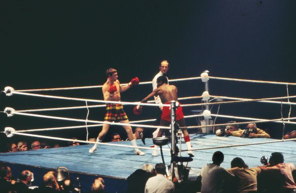 Boxing - WBA World Lightweight Title - Ken Buchanan vs. Al Ford Scotland's Ken Buchanan (tartan shorts) during his victory over Canada's Al Ford (red shorts) in the Empire Pool, Wembley, London