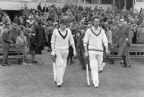 Cricket - 1957 County Championship - Yorkshire bt Somerset by innings and 48 runs Kenneth Taylor, left, walks out to bat with Frank Lowson at Headingley