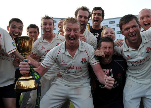 Cricket - LV County Championship - Somerset vs. Lancashire Captain Glen Chapple and his Lancashire team celebrate with the championship trophy at the County Ground, Taunton