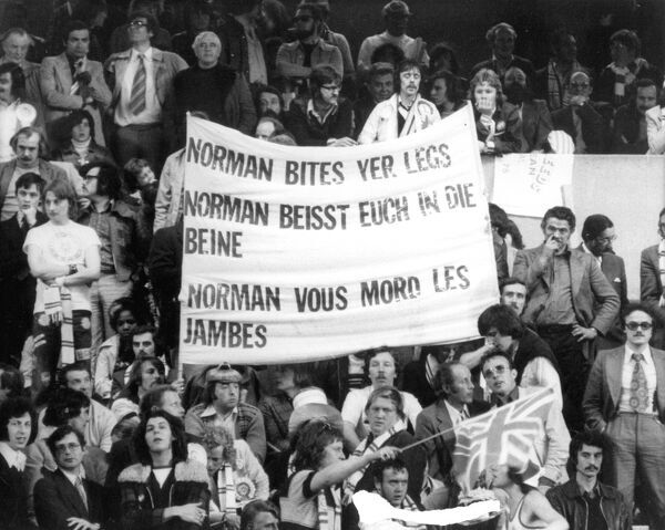 Football - 1975 European Cup Final - Bayern Munich 2 Leeds United 0 Leeds United fans with a banner reading 'Norman bites yer legs' (in reference to Norman Hunter) in English, German, and French in the stands at the Parc Des Princes, Paris
