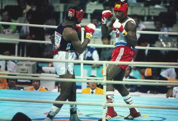 Boxing - 1988 Seoul Olympics - Men's Super-Heavyweight Final: Lennox Lewis (Canada) vs. Riddick Bowe (USA) Lennox Lewis (right) on the way to defeating Riddick Bowe to win the gold medal in the Jamsil Students' Gymnasium, Seoul Sports Complex