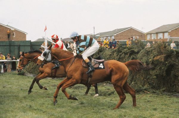National Hunt Horse Racing - Aintree Grand National 1975  Eventual race winner L'Escargot ridden by Tommy Carberry (4) jumps Valentines, with The Dikler ridden by Ron Barry behind