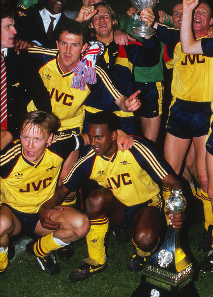 Football - 1988 / 1989 First Division - Liverpool 0 Arsenal 2     Arsenal players celebrate the title with the League Championship Trophy after the game at Anfield