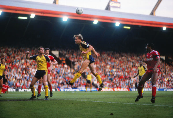 Football - 1988 / 1989 First Division - Liverpool 0 Arsenal 2    Lee Dixon and Steve Bould of Arsenal clear the danger at Anfield    26/05/1989