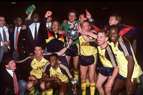 Football - 1988 / 1989 First Division - Liverpool 0 Arsenal 2    Arsenal players celebrate with the League Championship trophy after winning the title at Anfield.    Back row (l-r): Brian Morrow, Paul Davis, Kevin Campbell, Paul Merson, John Lukic