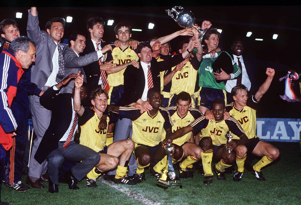 Football - 1988 / 1989 First Division - Liverpool 0 Arsenal 2     Arsenal players celebrate the winning the title with the League Championship Trophy after the game at Anfield.     Back row - Theo Foley, Miller, Steve Morrow,Niall Quinn, Alan Smith