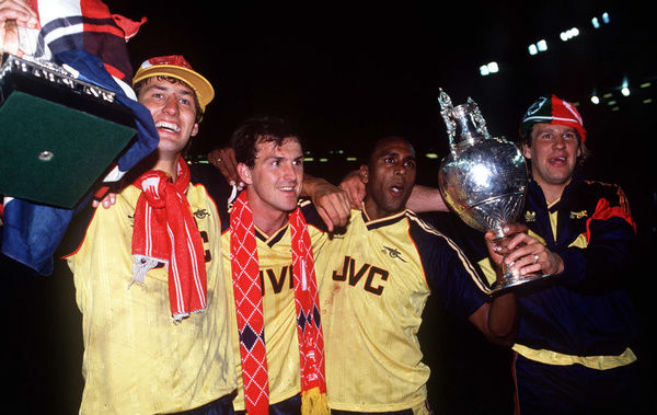 Football - 1988 / 1989 First Division - Liverpool 0 Arsenal 2     Arsenal players celebrate the winning the title with the League Championship Trophy after the game at Anfield