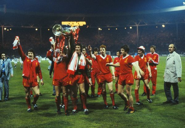 Football The Liverpool team celebrate with the trophy