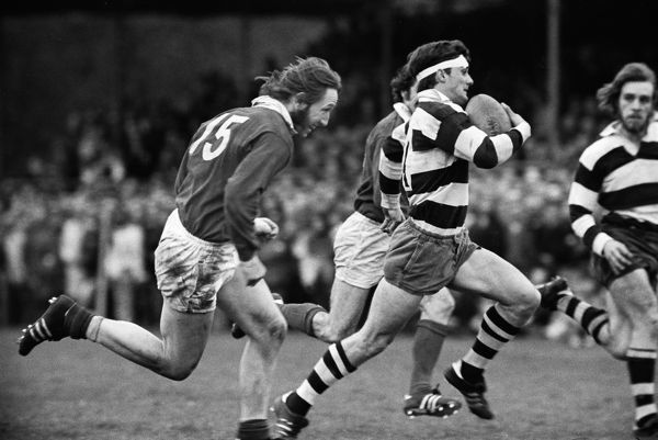 Rugby Union - 1972 / 1973 RFU Club Knock-Out Competition - Semi-Final: London Welsh 15 Bristol 18 Bristol's Peter Knight is pursued by Welsh's JPR Williams (#15) at Old Deer Park. 14/04/1973 Knight won three caps for England in 1972