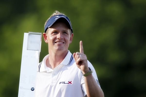 Golf - BMW PGA Championship  Luke Donald of England hold the trophy and one finger aloft to signify that he is worlds number 1 after beating Lee Westwood of England in a play off at Wentworth Club, Surrey