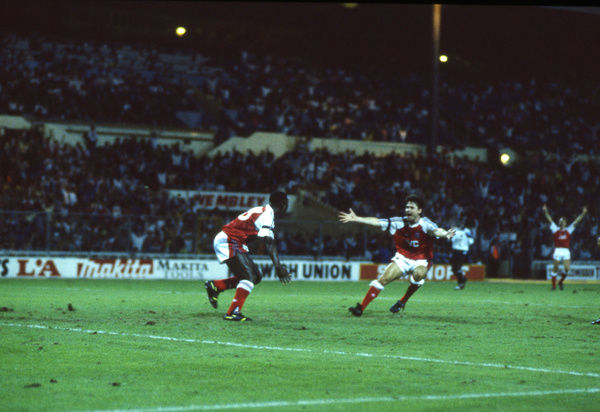 Football - 1990 Makita International Tournament - Arsenal 2 Aston Villa 0     Kevin Campbell celebrates scoring the second goal for Arsenal, with Anders Limpar, at Wembley.     10/08/1990