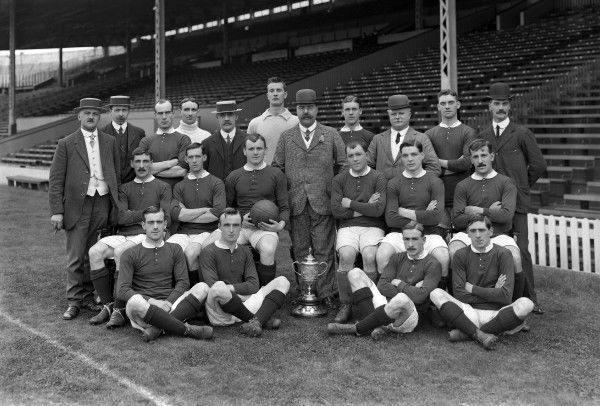 Manchester United 1909 FA Cup Winners 1908 / 09 Season. team group. Back row : L to R. Ernest Mangnall (Scretary / Manager),F.Bacon (trainer),Jack Picken,Hugh Edmonds,Mr.Murray (director),Harry Moger,John Henry Davies (Chairman),Tom Homer,Mr Lawton (director)
