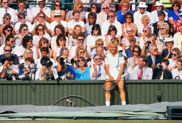 Tennis - cente court.  Martina Navratilova takes a breather with the crowd after running for a ball.  Women's Semi final: Navratilova v Chris Evert.  Wimbledon tennis Championships 1988.  Credit: Colorsport / Andrew Cowie