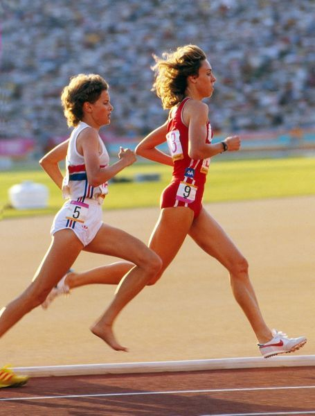 Athletics - 1984 Los Angeles Olympics - Women's 3000 metres Final Great Britain's Zola Budd and the USA's Mary Decker before their infamous collision in the Los Angeles Memorial Coliseum, which put Decker out of the race