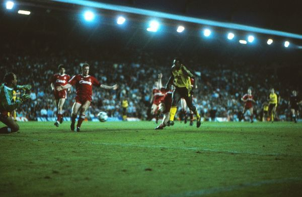 Football - 1988 / 1989 First Division - Liverpool 0 Arsenal 2     Michael Thomas of Arsenal scores his title-winning goal in the last minute of the final game of the season, past Steve Nicol and goalkeeper Bruce Grobbelaar, at Anfield