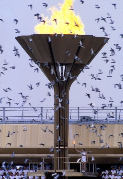 Moscow Olympics 1980 - Opening Ceremony Soviet basketball player Sergey Belov lights the Olympic cauldron as doves are released in the Grand Arena, Central Lenin Stadium Area, Moscow, USSR