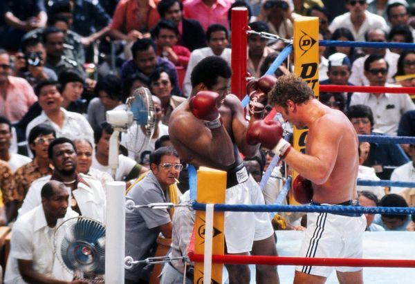 Boxing - World Heavyweight Championship (WBC & WBA) Title Fight - Muhammad Ali vs. Joe Bugner II Ali is pinned to the ropes by Bugner as Ali's cornermen Wali Muhammad and Angelo Dundee look on from ringside in Kuala Lumpur, Malaysia