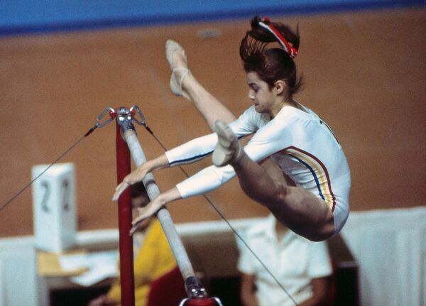 Gymnastics - 1976 Montreal Olympics - Women's Uneven Bars Romania's Nadia Comaneci during the uneven bars in the Montreal Forum, Quebec, Canada