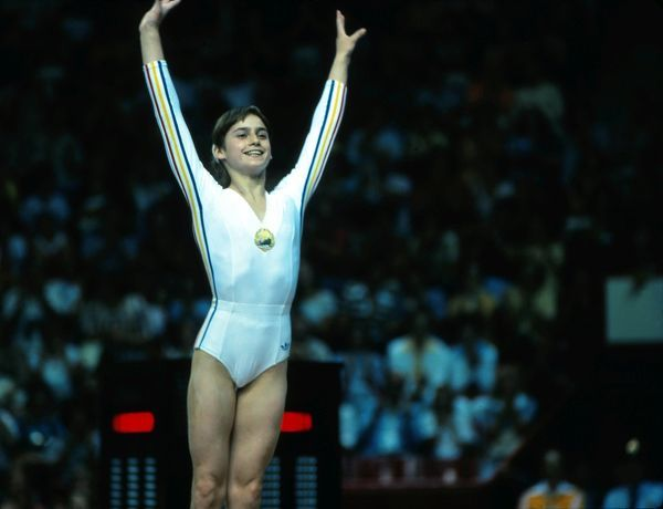 Gymnastics - 1976 Montreal Olympics Romania's Nadia Comaneci in the Montreal Forum, Quebec, Canada. Comaneci was the first Olympic gymnast to be awarded a perfect 10, in the uneven bars. She was awarded six further 10s as won golds in the beams