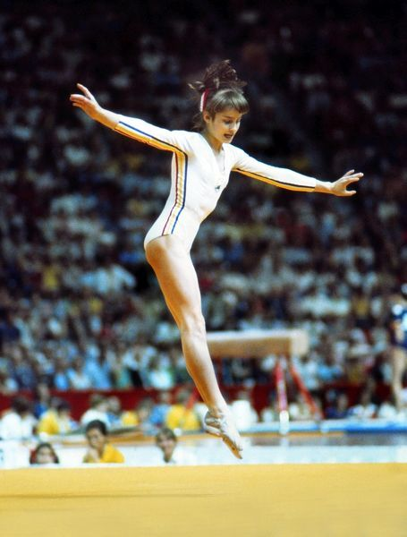 Gymnastics - 1976 Montreal Olympics - Women's Floor Exercise Romania's Nadia Comaneci on the way to winning the bronze in the floor exercises in the Montreal Forum, Quebec, Canada